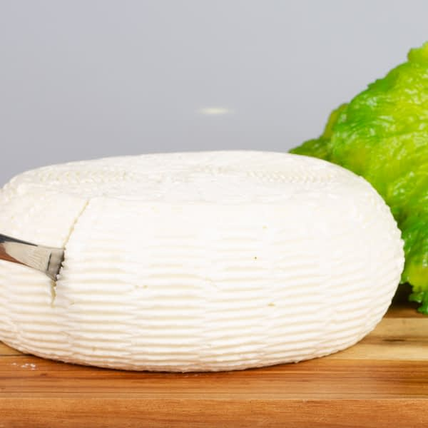 Sliced wheel of Stenby cheese
