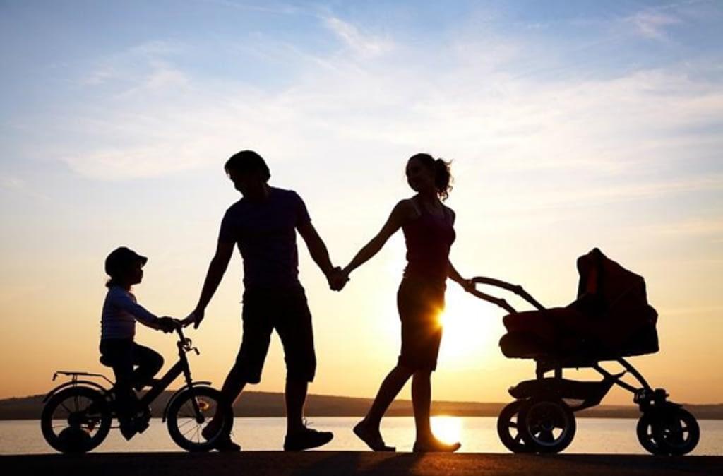 family going for walk with pram